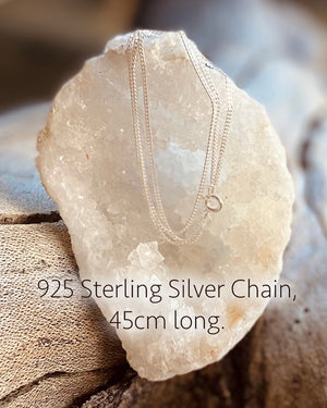 925 sterling silver small d-link chain, 45cm long. Draped over a sparkling white crystal cave.