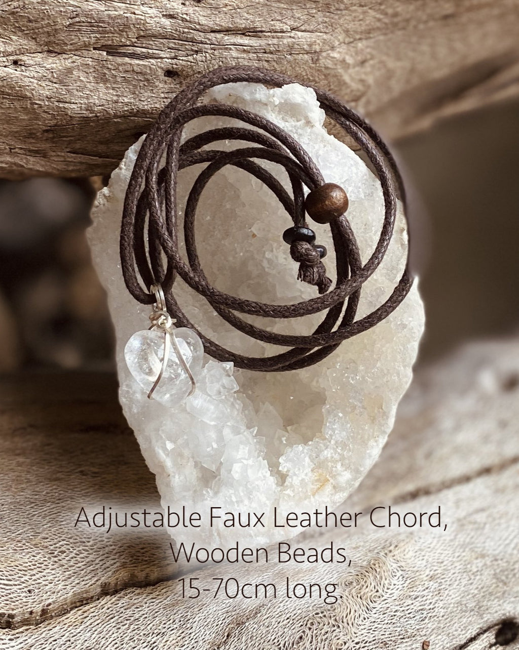 An adjustable length faux leather chord with wooden beads for wearing a crystal pendant. Brown in colour.