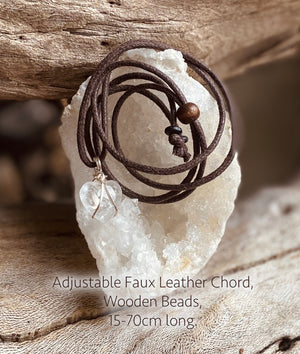 An adjustable length faux leather chord with wooden beads for wearing a crystal pendant.