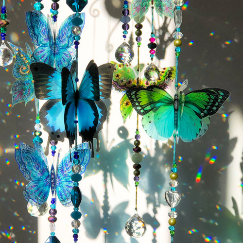 Hand made crystal suncatcher chandelier with an aqua, blue and green butterflies. Made in Byron Bay, Australia.