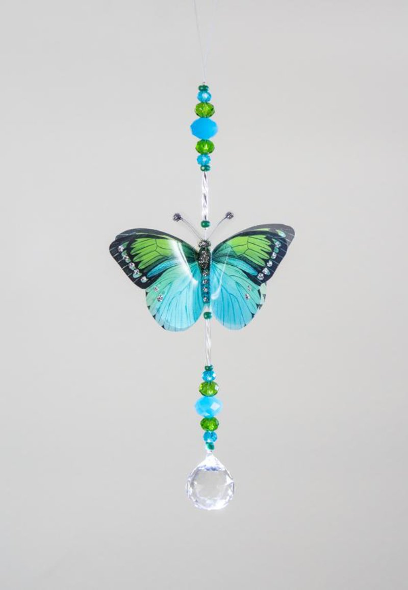 Hand made crystal suncatcher with an aqua and green butterfly motif. Made in Byron Bay, Australia.