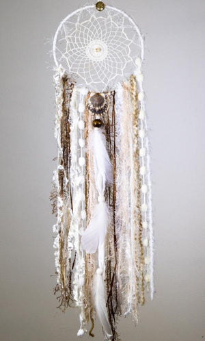 Handmade boho dream catcher by visionary artisan Kylee Joy in neutral brown, white and cream tones.