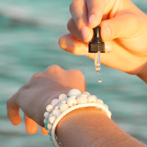 2ml Essential Oil dispenser bottle with Kylee Joy's hand made crystal and lava stone bracelets.