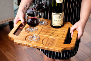 Hostess holding a custom engraved wine board