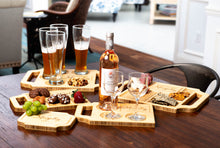 An array of Blonde-finished custom charcuterie boards and wine boards