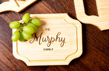 A small custom charcuterie board with family name engraving