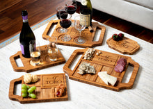 A variety of personalized charcuterie boards and wine boards with engravings