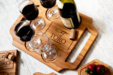 Custom engraved wine board with wine bottle and glasses