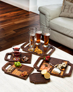 A variety of custom charcuterie boards and cocktail boards with beverages and assorted snacks