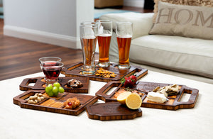 An array of custom charcuterie boards and engraved wine boards