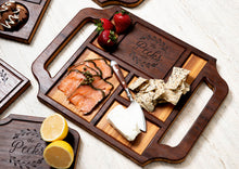Custom charcuterie board with handles displaying meat and cheese assortment