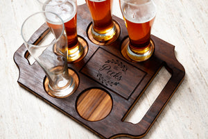 A custom cocktail board with handles and beverage glass slots