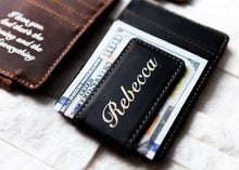 A close-up of the Bad Guy Black Inked Message Magnetic Leather Money Clip with clip