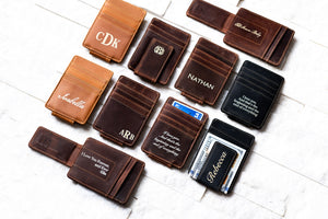 An arrangement of Inked Message Magnetic Leather Money Clips in all three colors with various messages