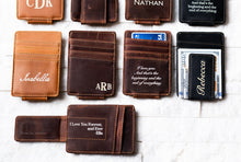 A line of Inked Message Magnetic Leather Money Clips with various messages