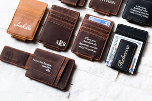 An arrangement of Inked Message Magnetic Leather Money Clips in all three colors