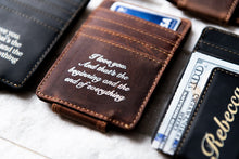 A close-up of the Saddle Brown Inked Message Magnetic Leather Money Clip