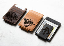 Three Star Wars Inspired Leather Magnetic Money Clips with engravings of the Millennium Falcon, Yoda, and the Mythosaur