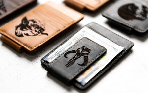 Three Star Wars Inspired Leather Magnetic Money Clips with engravings of Yoda and the Mythosaur
