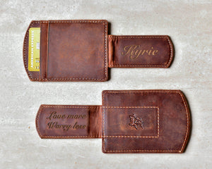 Two Super Slim Personalized Leather Magnetic Money Clips displaying the engravings on the clips