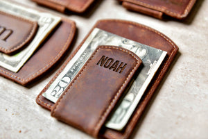 Close-up of the Super Slim Personalized Leather Magnetic Money Clip with money under engraved clip