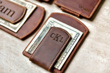 Close-up of the Super Slim Personalized Leather Magnetic Money Clip holding twenty dollars