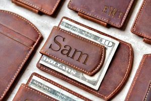 "Super Slim Personalized Leather Magnetic Money Clip holding 10 dollars. The name ""Sam"" is engraved on the clip."