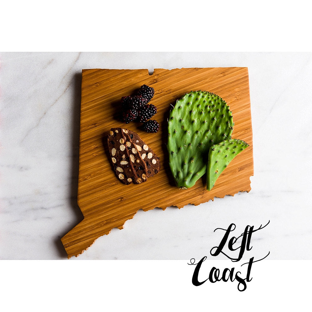 Connecticut State Shaped Cutting Board on a marble countertop