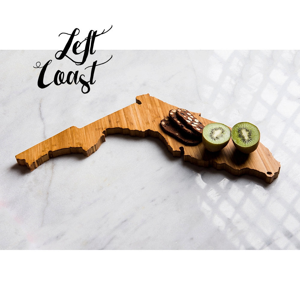 Florida State Shaped Cutting Board displaying kiwi and snack crackers