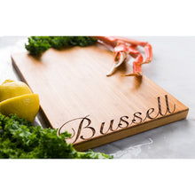 Script Font Personalized Bamboo Cutting Board with ingredients around it