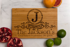 Family Name Monogrammed Bamboo Cutting Board surrounded by fruit