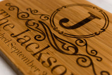 Close-up of monogram on Family Name Monogrammed Bamboo Cutting Board