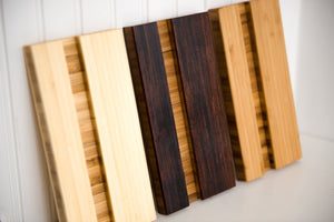 Cutting board stands in each color lined up in a row