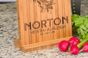 Cutting board stand displaying a personalized bamboo cutting board