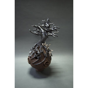 "Other side: Black Tree  Clay sculpture, Black Mountain Sculpture Clay and underglaze, 23""x18""x18""."