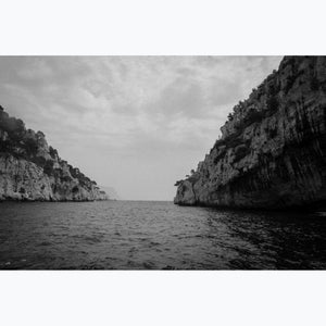 Mouth of the Calanque, cliffs, sea, trees, clouds, black and white photo, France