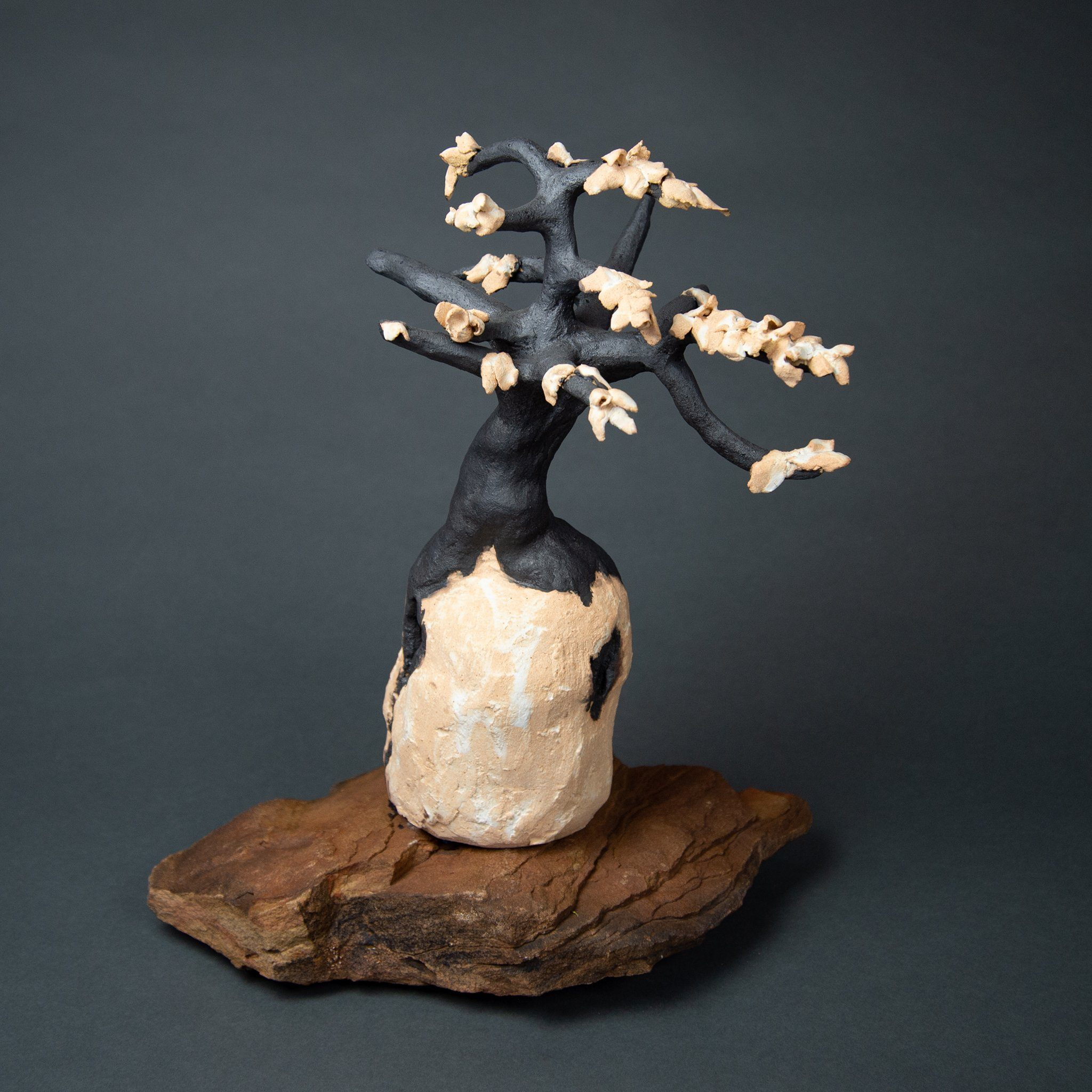 Gold Tree, clay sculpture on flagstone base