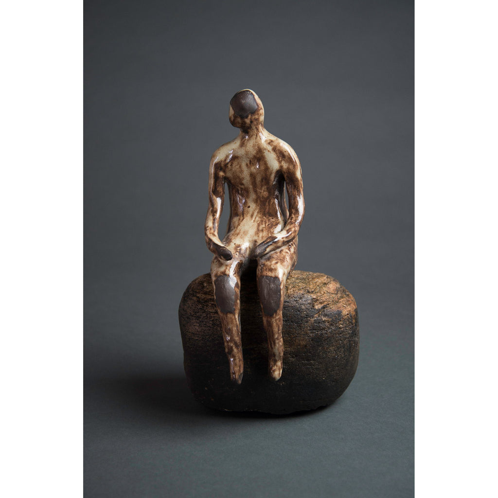 Man on Rock  New Mexico Chocolate clay, Shino, glaze and river rock, 10.75x6x5, front
