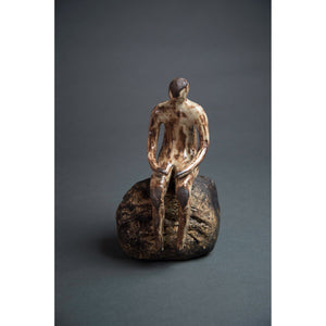 Man on Rock 2,  New Mexico Chocolate clay, Shino, glaze and river rock, 10.75x6x5, front.