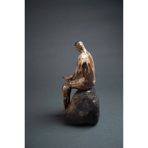Man on Rock 2,  New Mexico Chocolate clay, Shino, glaze and river rock, 10.75x6x5, back-side view.