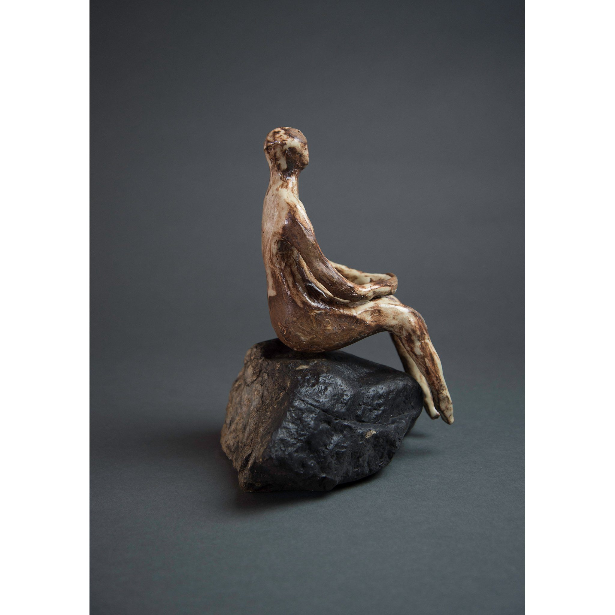 Man on Rock 3  New Mexico Chocolate clay, Shino, glaze and river rock, 10.25x10x5, side two.
