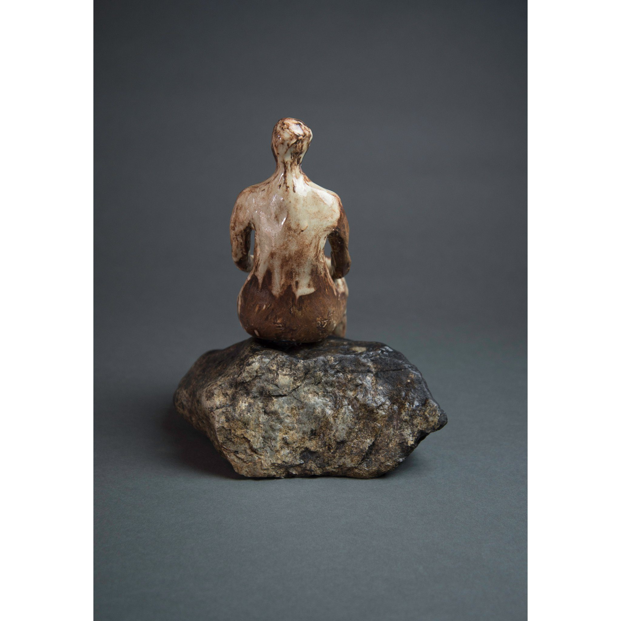 Man on Rock 3  New Mexico Chocolate clay, Shino, glaze and river rock, 10.25x10x5, back.