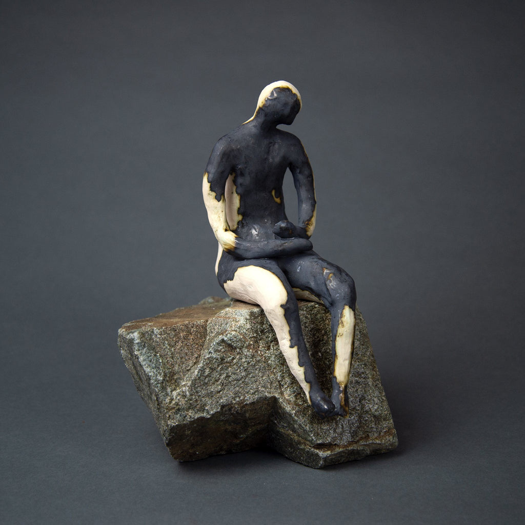 Man on Rock 19-4, porcelain clay and oxides on granite base, 9.5x6x11.5