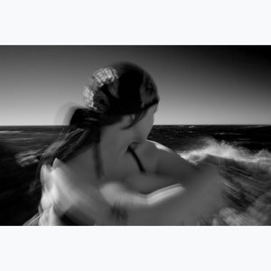 Wave Gazing, woman with bandana gazes out sea, waves, break, black and white