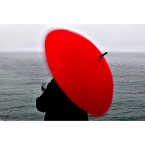 Woman with Twirling Red Umbrella