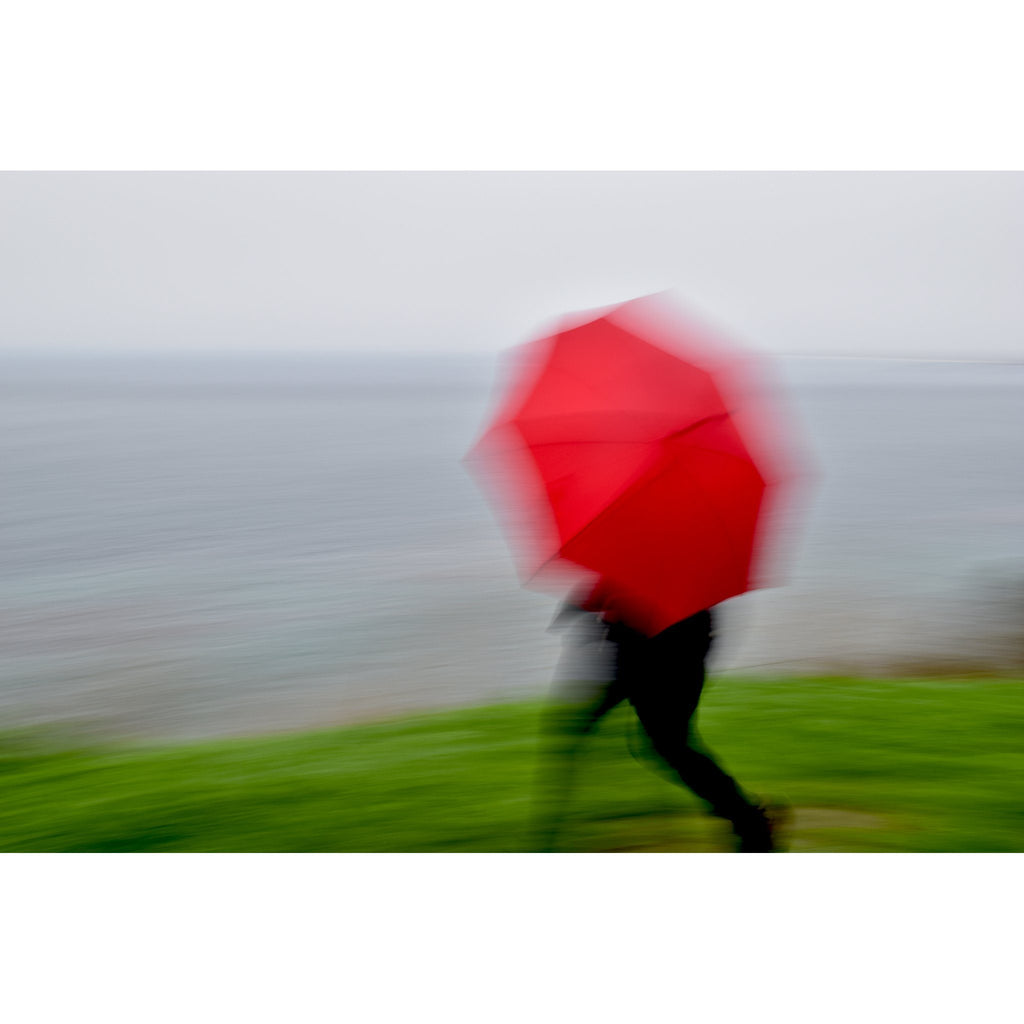 Woman Running with Red Umbrella