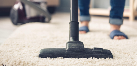 How to care for carpet: remove dirt particles with a vacuum cleaner