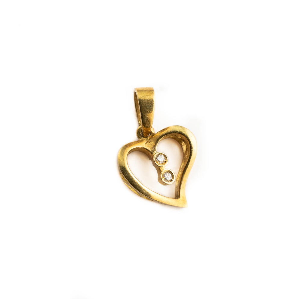 Woman heart pendant in 18kt yellow gold 750/000 with white zircons