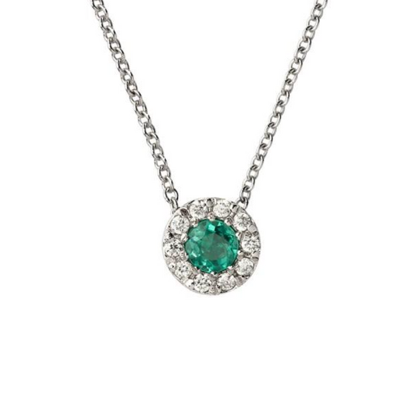 woman necklace with diamonds and emeralds