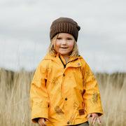 Girls raincoat - Girl wears mustard yellow Wild Island kids waterproof rain jacket outdoors